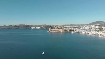 Castle of St. Peter overlooking the mediterranean seaside of Bodrum, Turkey - Orbit panoramic aerial shot video