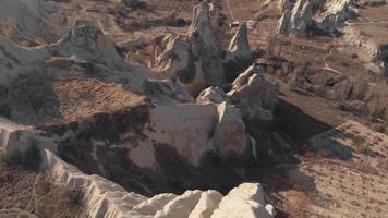 Rocks formation in Cappadocia, Turkey. Aerial tilt up video