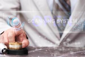 Businessman finger print press  button on virtual screen photo