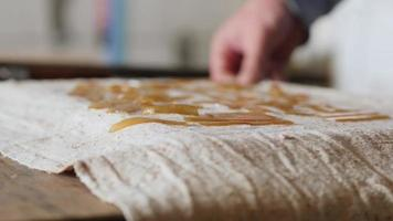 man lays out chopped wood glue for drying video