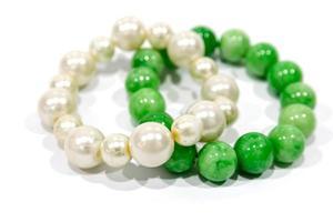 Pearl bracelets isolated on white background photo