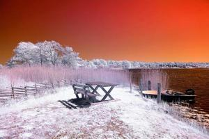 Picnic table under a red sky photo