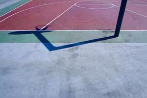 hoop shadows on the street basketball court photo