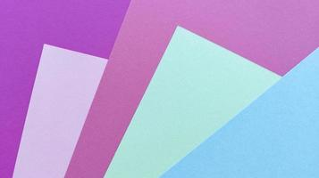 Multicolored pastel texture background Purple pink green blue sheets on photo