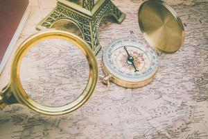 Looking France on world map using a magnifying glass soft focus photo