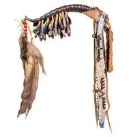Dance rattle of the North American Indian horn with deer hooves and feathers photo