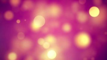 hermoso bokeh amarillo sobre fondo rosa gráficos en movimiento video