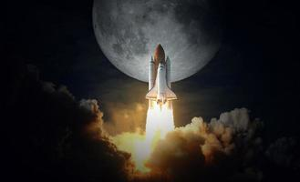 Space shuttle takes off to the moon, elements of this image furnished by NASA photo