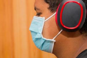 Black man with headset and blue protective mask against coronavirus in rio de janeiro photo