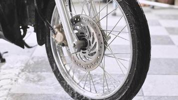 Spray water to wash the bubbles off the front wheels of the motorcycle video
