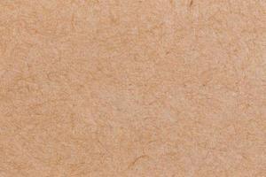 Close-up de fondo de textura de tablero de corcho de color marrón foto