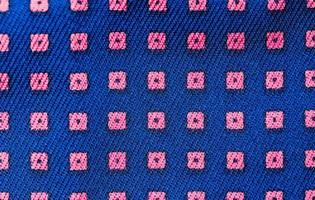 Solid background of blue fabric with a texture pattern photo