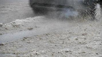 dirty road slow motion splashing mud from the car video