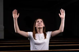 A Christian girl praying with humble heart in the church photo
