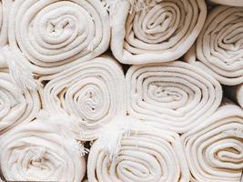 Close up on many stacking white carpet rolls photo