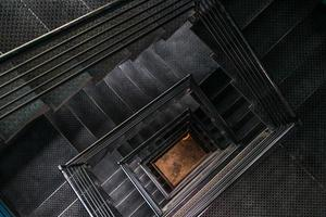 Square steel stairwell view from the top photo