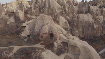 Circling, 4k aerial drone footage of the cone-shaped formations in Cappadocia of central Turkey. The area is known for its distinctive fairy chimneys which often are used as homes. video
