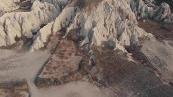 4k aerial drone footage flying over and revealing the unusual landscape of the valleys and rock formations of Cappadocia in central Turkey. video