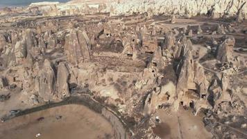 4k aerial drone footage of Cappadocia in central Turkey and its distinctive fairy chimneys, tall, cone-shaped rock formations often with homes carved into them. video