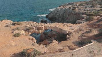 Aerial Drone View 4K Footage of Kamara Tou Koraka Stone Archt at Ayia Nappa, Cyprus video