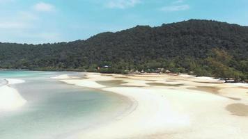 Paradisiac white beach with hammocks near the calm sea water. Koh Rong Samloem, Cambodia video