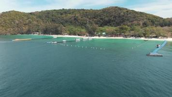 Aerial approaching the pristine beach of Coral Island, Thailand. Tropical holidays concept video