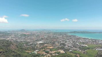 Top wide view over Mueang Phuket District urbanized tropical landscape in Phuket, Thailand - Aerial Wide top panoramic view video