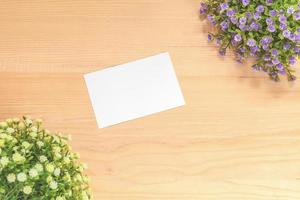 Paper note on wood background photo