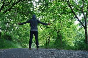 man trekking on the mountain photo