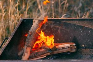 Burning charcoal in the fire for barbecue photo