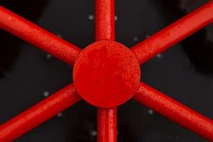 The red industrial part is similar to the steering wheel of a ship photo