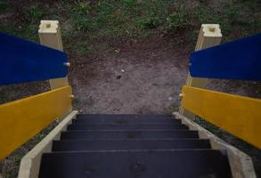 Children playground stairs with blue and yellow sides photo