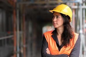 Woman engineer crossed arms photo