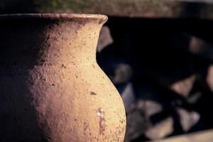 Ancient clay jug close-up outdoors on a sunny day photo