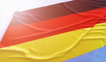 bandera alemana en el cielo azul foto
