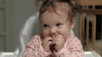 Little girl is playing with a wooden toy The development of fine motor skills video