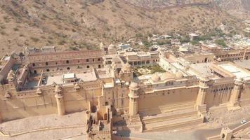 Wide View to the Amber fort Jaleb chowk and Aram Bagh surrounded by barren hills in Jaipur, Rajasthan, India - Aerial wide panoramic orbit shot video
