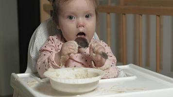 Little toddler girl eating porridge video