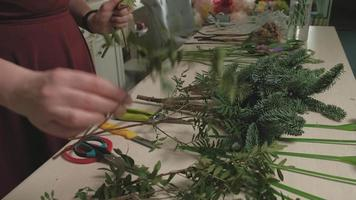 A Florist with A Table Full of Materials video