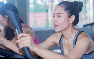Woman is exercising in the gym with a happy smiling face photo
