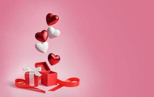 Hearts fall into gift boxes photo