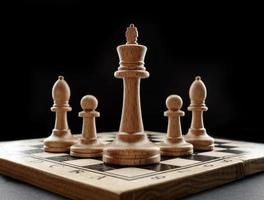 Chess board with figures on a black background photo