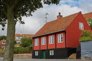 Traditional colorful half timbered houses on Bornholm island in Svaneke Denmark photo