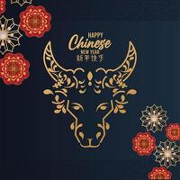 happy chinese new year card with golden ox head and flowers in blue background vector