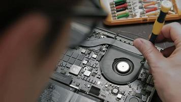A Man Working on A Laptop's Microchip video