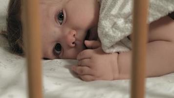A small child plays in the crib video