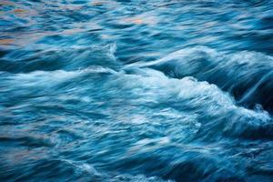 Rushing blue river photo
