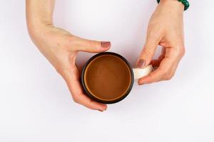 Holding a cup of coffee photo