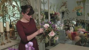 The work of the florist Creating a flower bouquet video