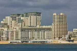 Residential and commercial area at the coastline of Valletta in Malta photo